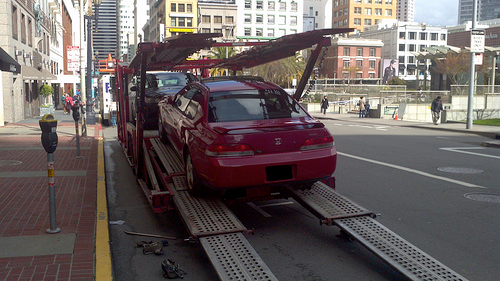 Red Car on Auto Transport Trailer